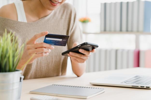 beautiful-asian-woman-using-smartphone-buying-online-shopping_7861-797